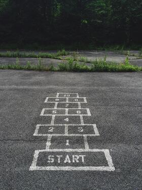 Numbers 1 to 10 on a hopscotch game